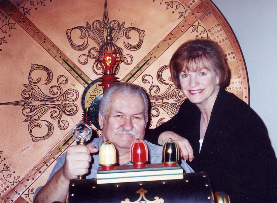 Bob and Kathy Burns, sitting in their refurbished original prop of THE TIME MACHINE from the 1960 movie starring Rod Taylor