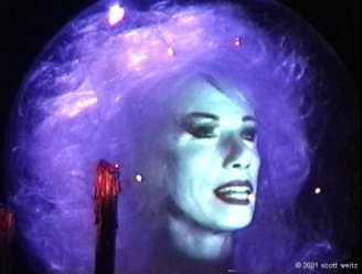 Madame Leota's disembodied head still summons spirits and thrills in The Haunted Mansion forth-three years later