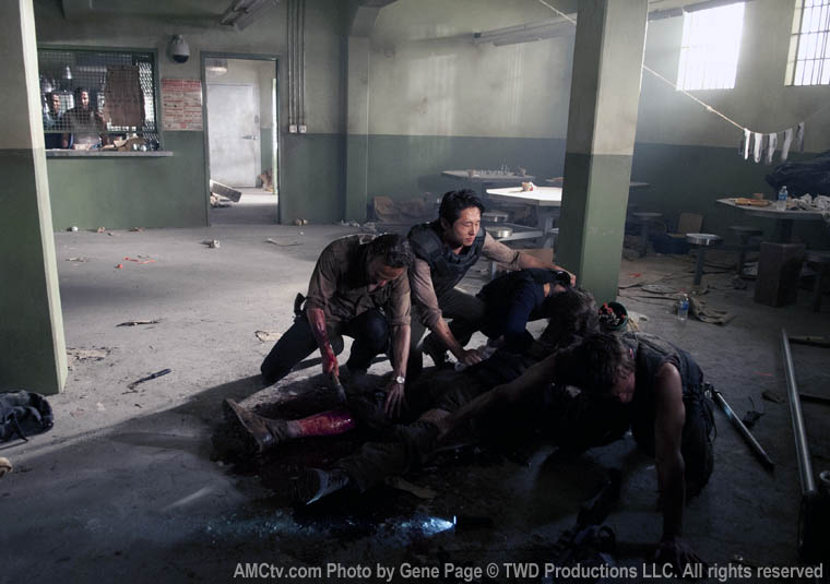 Rick Grimes (Andrew Lincoln), Glenn Rhee (Steven Yeun), Maggie Greene (Lauren Cohan), and Daryl Dixon (Norman Reedus) shorten Hershel Greene's (Scott Wilson) by a foot in Episode 2, Season 3 of THE WALKING DEAD. Photo by Gene Page/AMC c. TWD Productions LLC. All rights reserved.