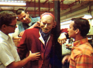Roger Broggie Jr. (right) and two other Imagineers test out an audio-animatronic figure for The Pirates of the Caribbean attraction.