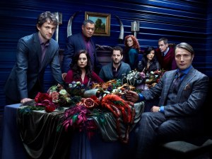 The cast of HANNIBAL starring Mads Mikkelsen (far right) as Dr. Hannibal Lecter, premiering April 4 on NBC.