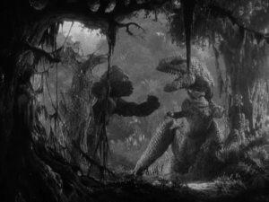 The mighty ape battles a Tyrannosaurus Rex on Skull Island in KING KONG (1933).