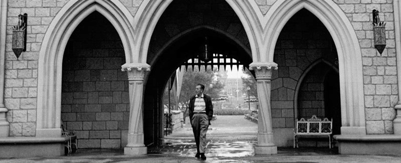Walt Disney enters the courtyard of his Disneyland castle before the first guests arrive for the day.