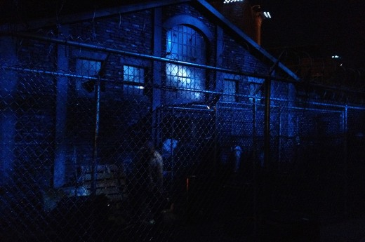 To enter the apparent safety of the prison, you must first get past the Walkers behind the fences and encounter THE WALKING DEAD: NO SAFE HAVEN maze at Halloween Horror NIghts - Hollywood. Photo © Scott Weitz. All rights reserved.