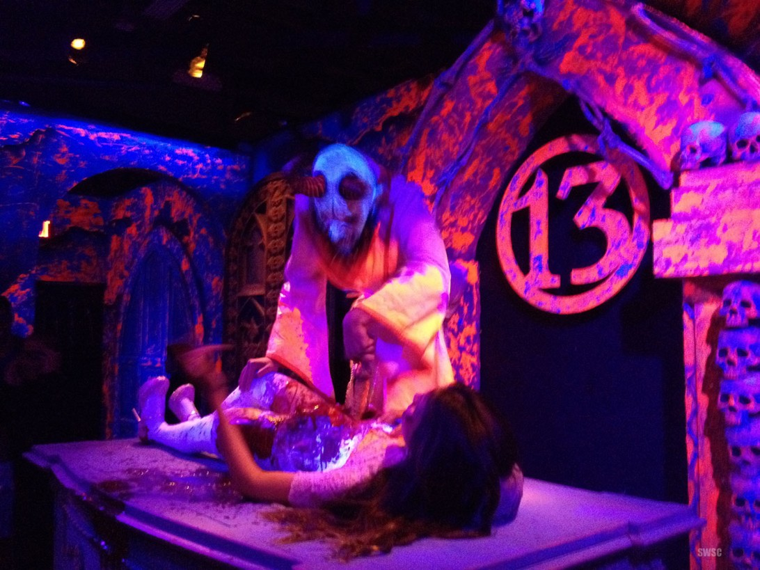 The BLACK SABBATH 13:3D maze at Halloween Horror Nights proves unlucky for this devil's victim sacrificed to the tunes of the legendary heavy metal band. Photo © Scott Weitz. All rights reserved.